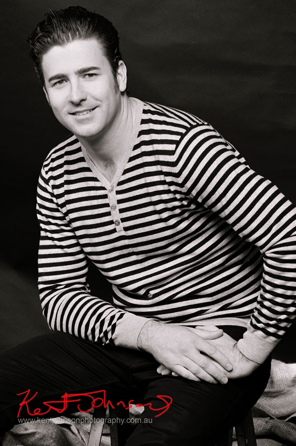 Male Modelling Portfolio, seated, striped casual shirt and jeans
