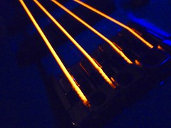 Bridge (Fotografie di Pablo) Tags: light red orange black hot wire neon toaster bass guitar dr strings glowing