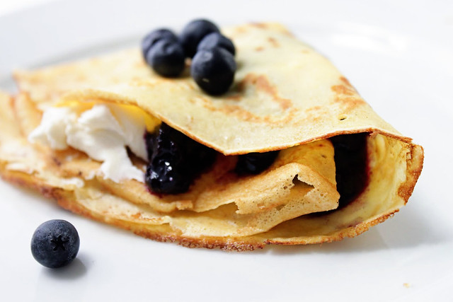 ... blackberries and a sprinkling of powdered sugar to her crepes! And why