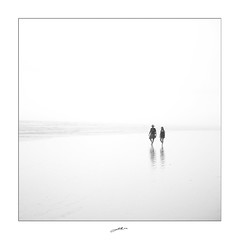 A Couple in the Rain (Geoff Sills) Tags: bw white abstract black reflection love beach wet water rain st fog walking square haze sand nikon couple quiet open florida walk geoff horizon wide dream overcast together rainy journey 28 stroll augustine 2470 sills d700