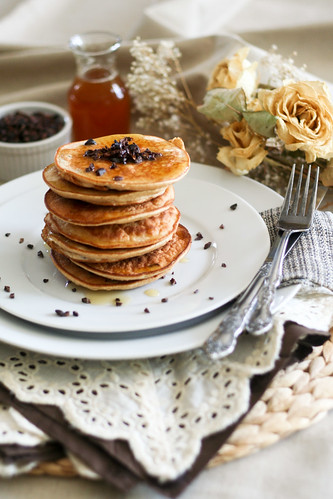 A plate of coconut and cocoa nibs pancakes