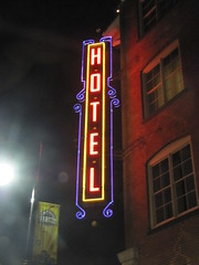 Neon beacon (jimsawthat) Tags: urban brick night neon glare kansas hotels wichita metalsigns vintagesigns oldtownwichita