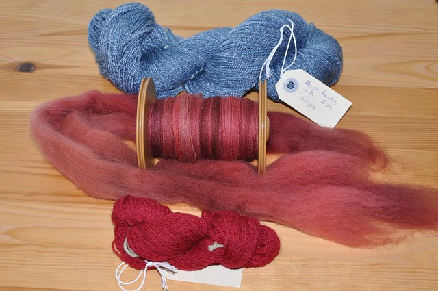 Two skeins and a bobbin.