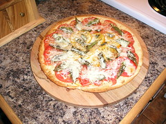 home made pizza, pizza maker, making pizza,