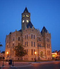 Lavaca County Courthouse at Night (maorlando God kept us 2012 leaning on Him 2013) Tags: travel windows summer usa tower stone architecture sandstone texas arches historic ironfence lampposts smalltowns seththomasclock lavacacountycourthouse twilighthour texasscenes top20texas halletsvilletx millscountybrownsandstonegreystone built18971899