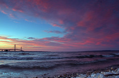 Mackinac Bridge (Kevin Povenz) Tags: bridge blue sunset red lake water yellow rocks waves michigan mackinac mackinaw tpslandscape