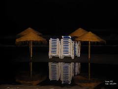 Merecido descanso nocturno / deserved night's rest (Santos M. R.) Tags: sea beach night mirror noche mar natural playa espejo reflejo umbrellas sombrillas hamacas