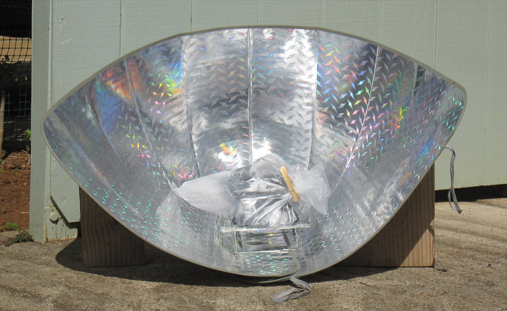 Solar cooker made from car window shade