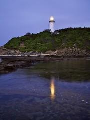 Reflections on a Lighthouse (Peter Knott) Tags: ocean longexposure morning lighthouse seascape reflection water sunrise reflections dawn lights shorelines shoreline australian australia olympus shore nsw e3 zuiko gitzo zd norahhead 1260mm newcastlesundance gt2542l