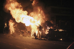 the burning corpse of a bus by againsthoping
