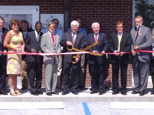 The ribbon cutting photo includes from left to right: Donna McClure, Sen. McConnell's office, Mark Johnson, Kentucky Cabinet for Economic Development, Earl Gohl, Co-Chair of the Appalachian Regional Commission, Congressman Hal Rogers, Tom Fern, Kentucky State Director, Bill Singleton, Kentucky Highlands Chairman, and Jerry Rickett, Kentucky Highlands President.