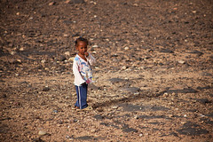 Alone (TheFella) Tags: africa street travel slr girl digital canon photography eos photo alone child sad desert northafrica stones candid streetphotography photojournalism morocco photograph processing marrakech maghreb lone 5d lonely dslr ouarzazate markii travelphotography kingdomofmorocco 5dmarkii
