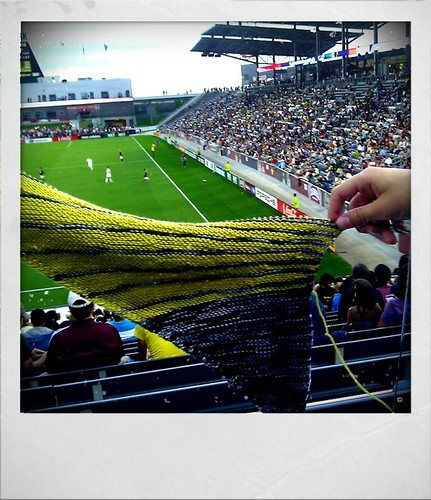 Knitting at the rapids game, paying the rain holds off