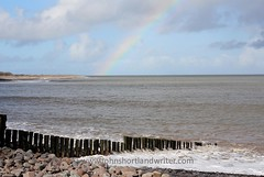 Exmoor: Over the Rainbow (john shortland) Tags: park sea england sky cloud rainbow waves spit somerset pebbles national weir breakwater exmoor porlock poyle