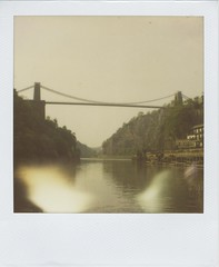 Suspension (Lizzie Staley) Tags: bridge light summer england reflection film water river bristol polaroid sx70 woods 600 week gorge leak expired suspensionbridge avon clifton brunel 2011 roidweek2011