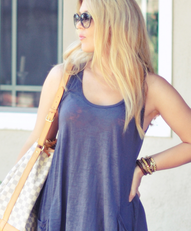 gray burnout     trapeze tank  with neon pink bra jeans and louis vuitton bag