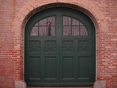 Evergreen - carriage house doors (karma (Karen)) Tags: windows reflections doors bricks carriagehouse maryland arches baltimore evergreen museums jhu mansions