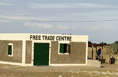 Free Trade Center (cowyeow) Tags: poverty africa street old silly weird town crazy funny village sad african empty centre free center wrong badsign irony rough ironic decrepit trade namibia freetrade funnysign dilapidated worldtrade rundown namibian uglybuilding funnyname ruacanafalls ruacana crapsign funnyafrica rundownbricks