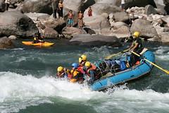 Paddling hard through rapids on the Kameng river Adventure rafting and Kayaking trip