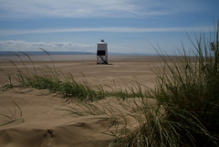 Burnham Lighthouse (Mukumbura) Tags: wood blue light england sky lighthouse beach grass stairs coast wooden sand lighthouses mud legs patterns dunes somerset safety mudflats navigation piles gettyimages burnhamonsea northsomerset exmoor quicksand northdevon lighthouseonlegs summertimeuk