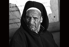 Inhabitant El Jadida (zilverbat.) Tags: travel portrait people bw man monochrome face square mono raw zwartwit expression candid streetphotography morocco looks portret lightroom reizen maturity lr3 streetcandid straatfotograf
