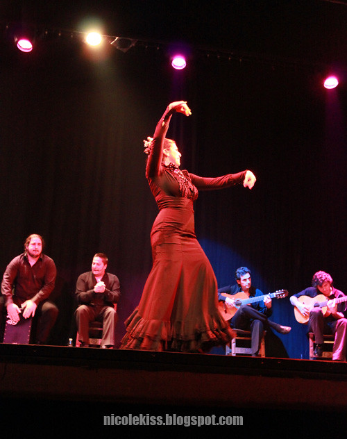 lady in black doing flamenco dance