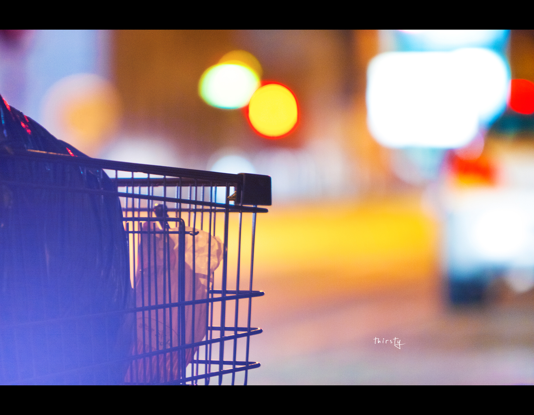 Project 365, Day 361, 361/365, Bokeh, flare, shopping cart, nightshot, bokeh balls, bokeh bubbles, canon EF 70-200 f2.8 IS,