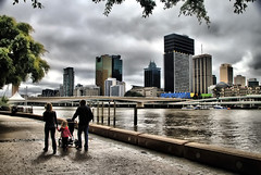 A Walk in Brisbane - Australia! (` Toshio ') Tags: city bridge family trees red people woman man water leaves architecture clouds buildings river walking couple cityscape child angle bright oz stroller walk australia brisbane southbank queensland boardwalk cbd ripples aussie southbrisbane brisbaneriver hdr highdynamicrange centralbusinessdistrict toshio