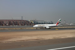 Emirates Triple7 on taxiway (DocAdvert) Tags: sky plane thailand asia dubai uae jet apron emirates airline boeing 777 runway docadvert unitedarabemirates dxb emiratesairlines 2011 triple7 ollikramp