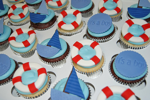 nautical themed baby shower cupcakes - sailboats, life preservers