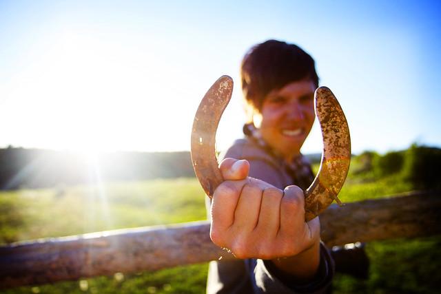 Black Mountain Colorado Dude Ranch man holding horseshoe