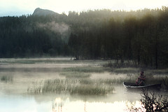 dinner (BricePortolano) Tags: wood lake water silhouette clouds boat weeds smoke lac pines barque