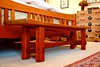 "Our bed bench.  I designed it to go with the bed we designed.  It's all through-tenons with square pegs of Bubinga, and cross-wedge through-tenons with Zebra wood wedges.  Cherry legs & trestle, with s scooped rounded mahogany top.  Took 10 days to make. • <a style=""font-size:0.8em;"" href=""http://www.flickr.com/photos/15929510@N02/5927398431/"" target=""_blank"">View on Flickr</a>"