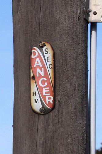 """Warning sign on a Melbourne power pole - """"DANGER: S.E.C. H.V"""""""