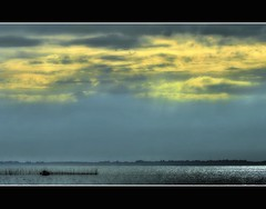 in the delta (Wim Koopman) Tags: light holland water netherlands dutch clouds reflections river photography photo nikon stock nederland atmosphere delta zeeland stockphoto stockphotography oosterschelde tholen poortvliet d90 estuarium oesterdam wpk