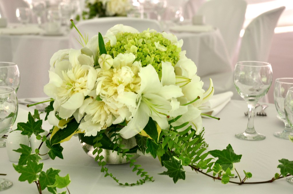 Rose bowls filled with peonies, Peruvian hydrangeas, lilies, fern, hosta and ivy