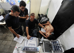 Sailors perform an echocardiogram on a patient...