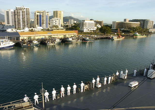 Sailors aboard the U.S. 7th Fleet flagship USS Blue Ridge man the rails prior to the ships port visit to Cairns, Australia.
