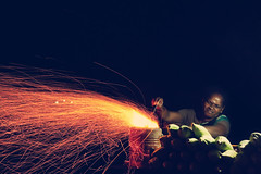 Corn Flames (VinothChandar) Tags: light people india beach lady night canon fire photography photo corn photos flames madras flame photograph chennai tamilnadu besantnagar elliotsbeach 5dmarkii