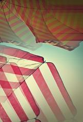 Karavostasi beach, prefecture of Thesprotia (Greece) - July 2011 (Fat and ugly) Tags: sea summer vacation sun holiday beach umbrella seaside holidays europa europe mediterranean stripes hellas july greece grecia balkans umbrellas griechenland europeanunion grece mediterraneansea ioniansea undermyumbrella ellada bythesea ionio     thesprotia karavostasi        ioniopelagos    pefectureofthesprotia