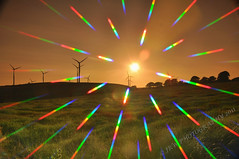 Wind Turbines (28/52) (JRT ) Tags: trees wallpaper sky sun grass electric metal clouds lens rainbow nikon niceshot power wind hill sunny generators lensflare flare sunburst rainbows filters blades turbines windturbines d300s doublyniceshot doubleniceshot tripleniceshot johnwarwood flickrjrt