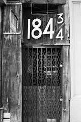 184 & 3/4 (Pine Ear) Tags: street nyc bw film 35mm kodak manhattan f14 voigtlander bessa trix 400tx doorway nokton greenwichvillage r2m