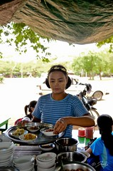 The waitress with a  lovely flower headband & tanaka painted cheeks (Icy_Aj) Tags: sunset temple pagoda buddha burma buddhism myanmar horsecart pagan bagan lacquerware buddhismarchitecture ricedish templearchitecture goldenland restaurantunderthetree