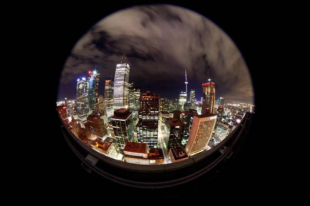 a rooftopping circular fisheye shot taken from a downtown toronto building at night