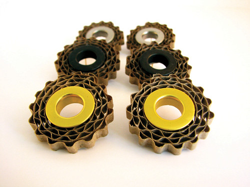 three pairs of corrugated cardboard earrings with gold, black, or silver filler tubes