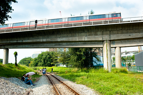 A MRT train rumbles above the old KTM tracks