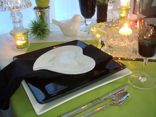 Romantic heartshaped plates are placed atop black and white ones with