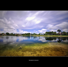(Shobeir) Tags: longexposure lake reflection landscape florida wideangle fortlauderdale cloudysky manmadelake cloudmovement sigma1020 lakereflection nd110 shobeiransari underwatermoss