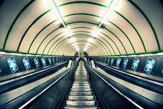 Paddington (Explore Front Page) (martinturner) Tags: london lines station stairs underground point angle curves escalator transport tube wide tunnel screen fisheye advert repetition paddington 8mm vanishing railings leading tfl samyang martinturner