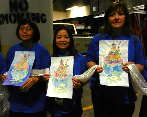 Happy Volunteers holding original watercolor paintings of Padmasambhava, Guru Rinpoche, with khatas, as offerings, preparing for mandala offering to His Holiness 14th Dalai Lama of Tibet, Kalachakra for World Peace, Verizon Center, Washington D.C., USA by Wonderlane